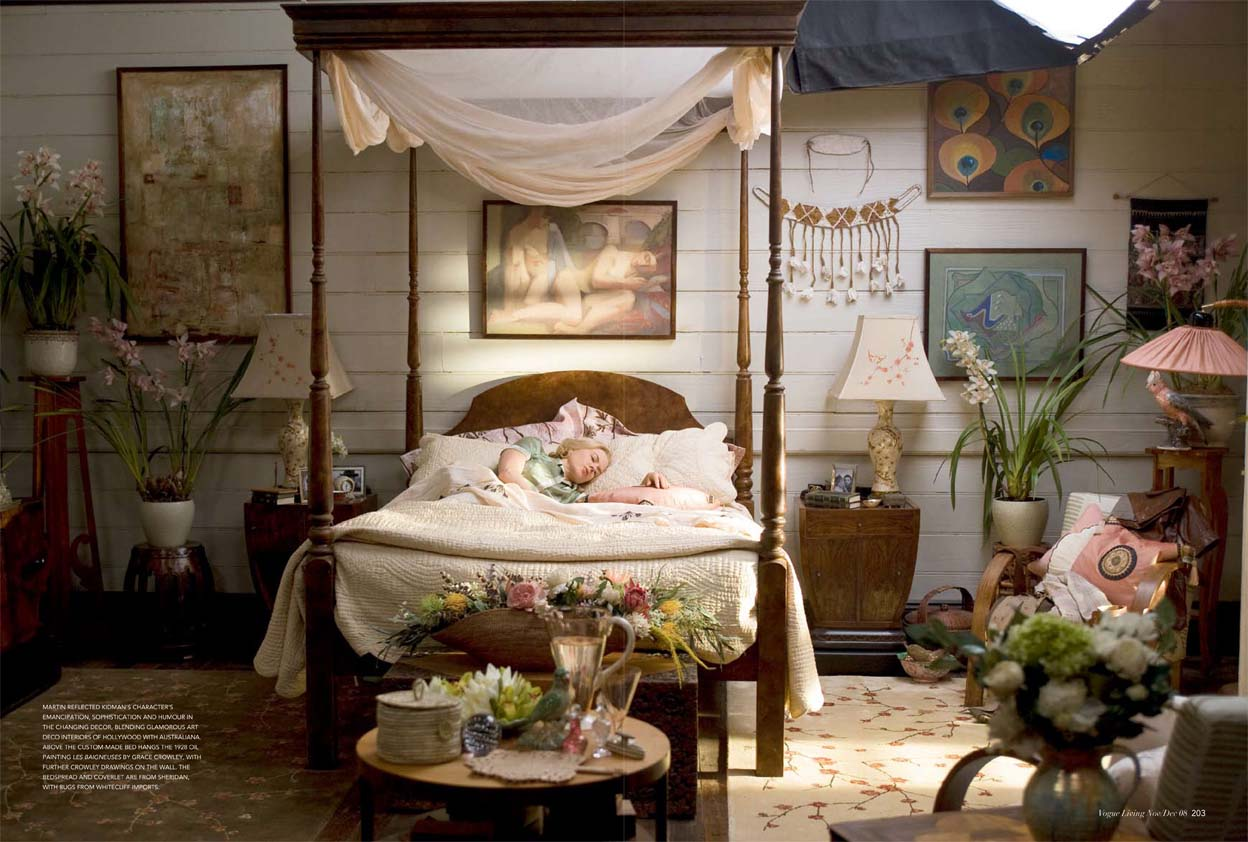 Four poster bed styled with a white canopy and corresponding bed sheets
