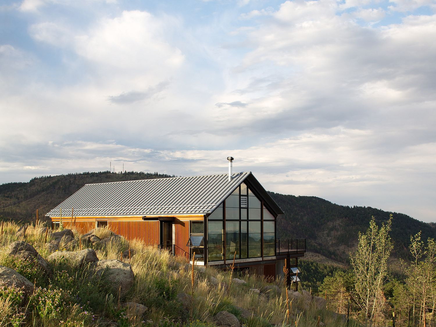 Gabled top level of the Sunshine Canyon House viewed from a distance