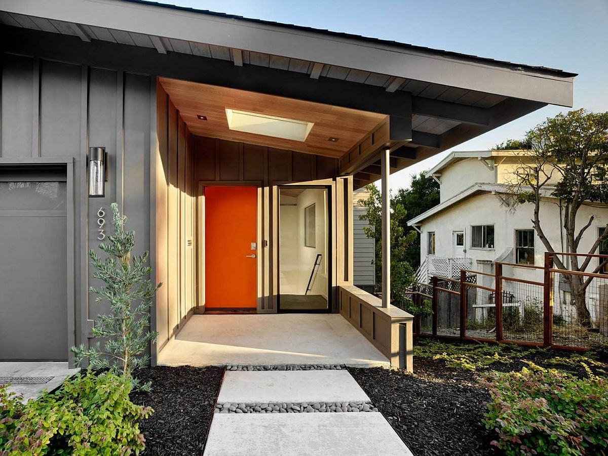 Midcentury with a Modern Zest Dashing Oakland Residence  : Gary exterior of the home with a gorgeous orange door and a cool entryway from www.decoist.com size 1200 x 901 jpeg 232kB