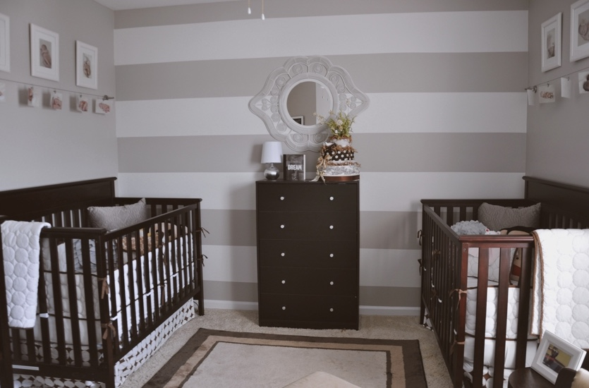 Gender neutral nursery with cream colored walls