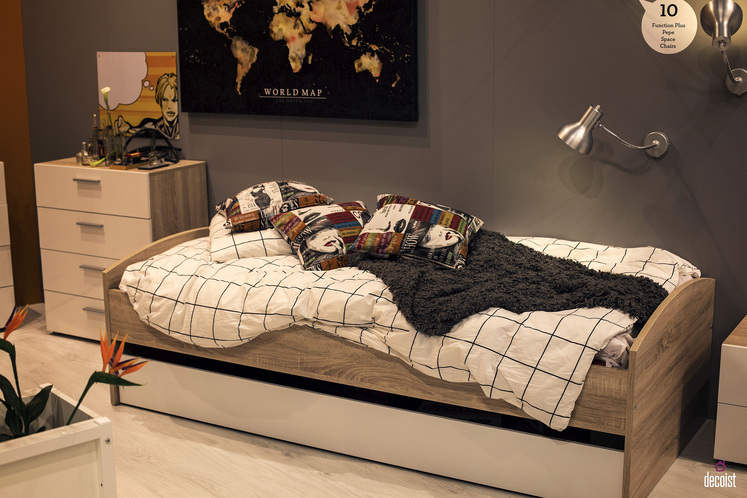 Glam up the teen room with a trundle bed and cool wall art