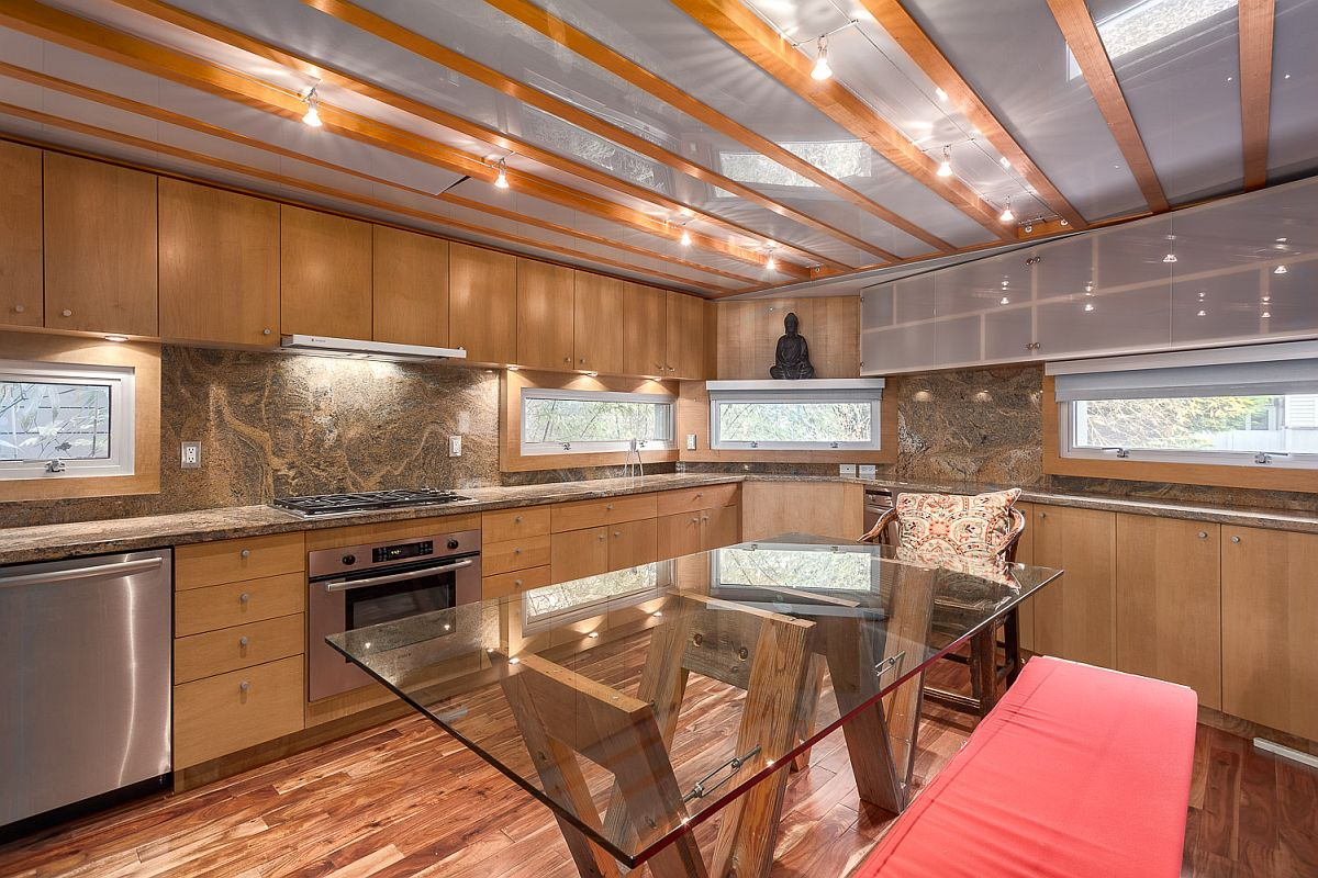 Glass and wood create an innovative ceiling for the kitchen