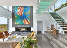 Glass-walkway-connects-the-two-different-wings-of-contemporary-home-in-Cape-Cod-217x155