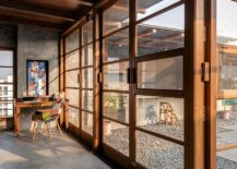 Glass-windows-and-doors-with-wooden-frame-connect-the-interior-with-the-patio-217x155