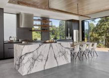 Gray-kitchen-with-a-stylish-kitchen-island-that-exudes-marble-sheen-217x155