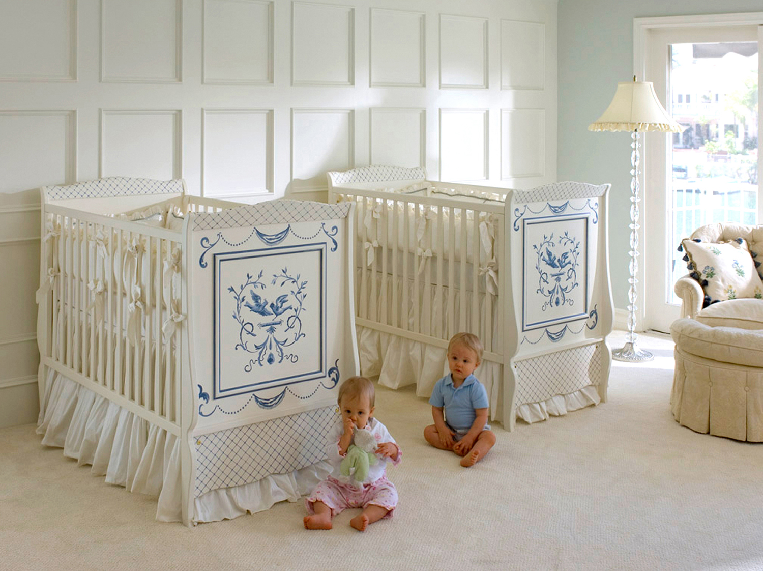 High cribs in a sunny twin nursery