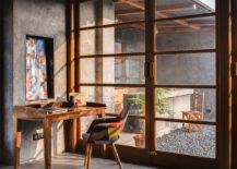 Home-library-and-workspace-on-the-top-level-connected-with-the-terrace-outside-217x155