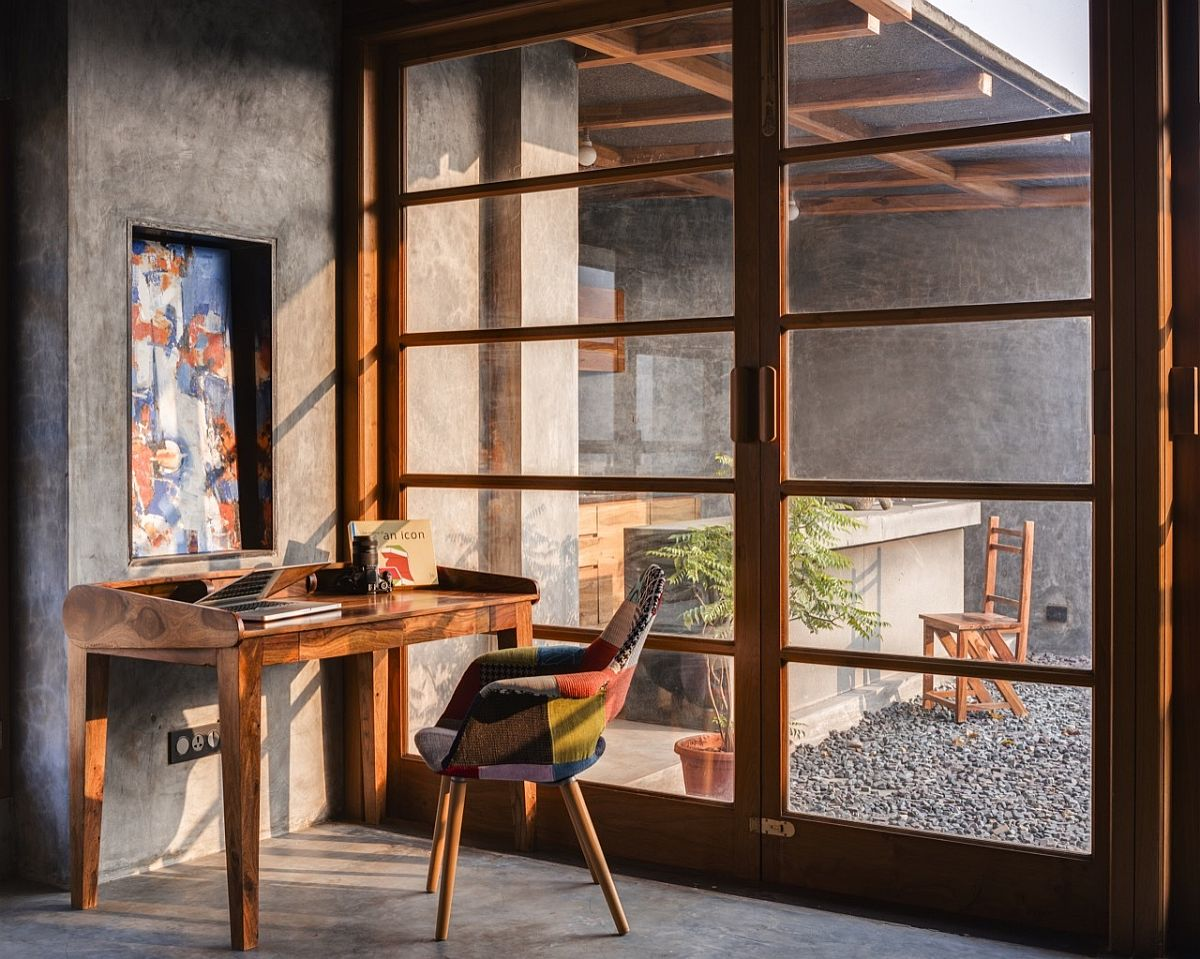 Home-library-and-workspace-on-the-top-level-connected-with-the-terrace-outside