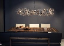 Imaginative-chandelier-above-the-dining-makes-a-big-visual-impact-217x155