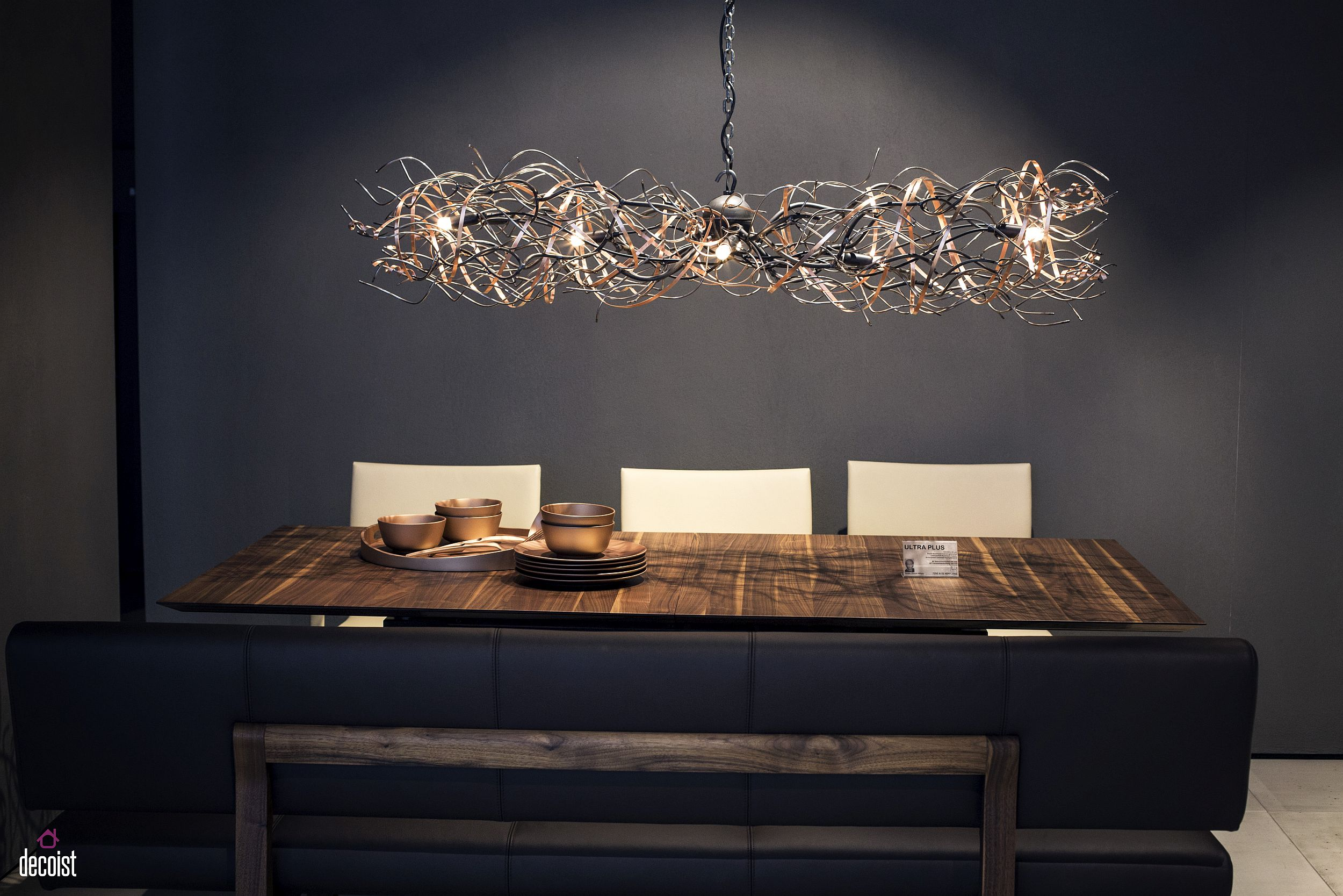 Imaginative chandelier above the dining makes a big visual impact