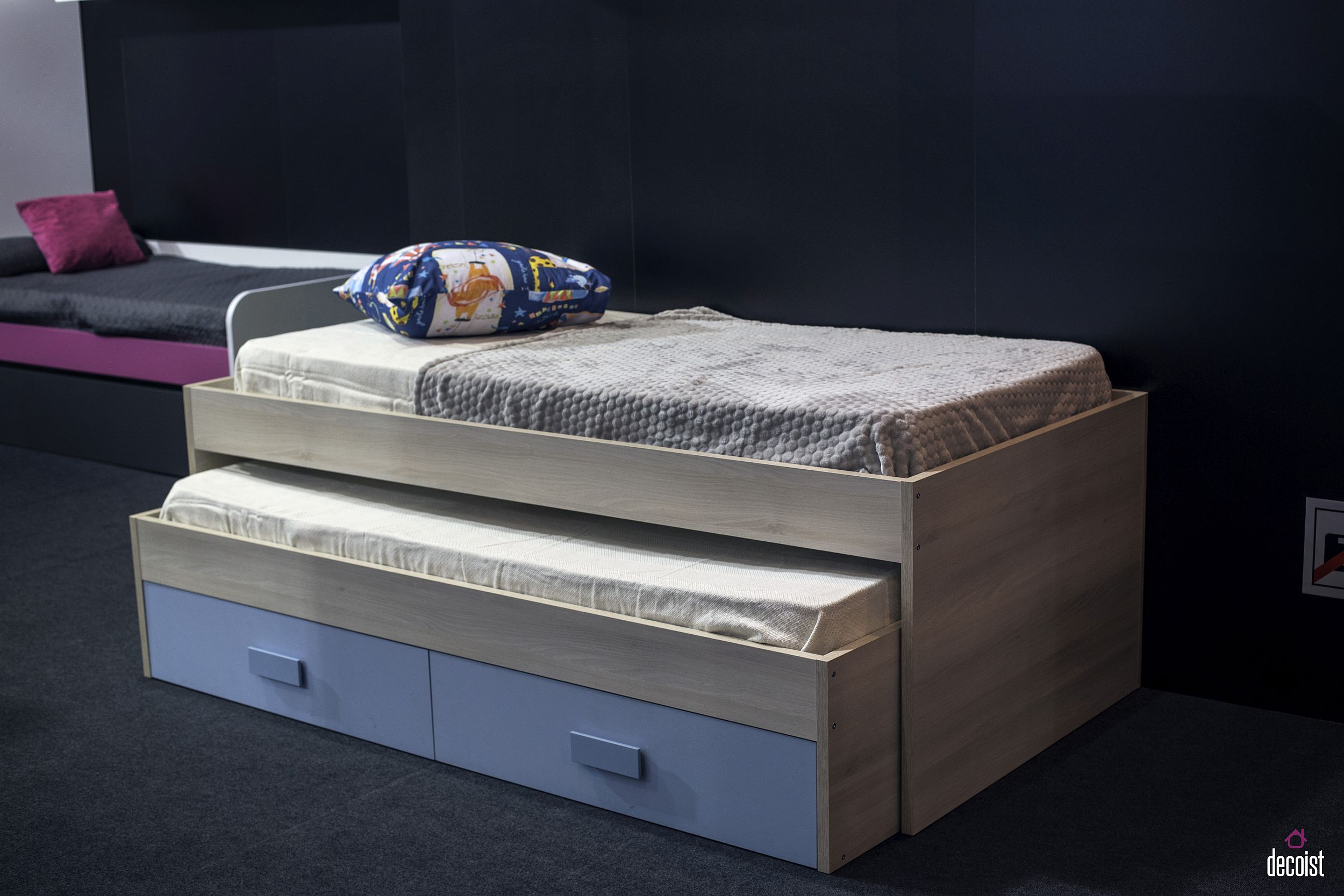 Kids' trundle bed with storage in elegant blue and wood