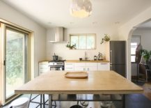 Kitchen-and-small-dining-space-rolled-into-one-inside-this-Canadian-home-217x155
