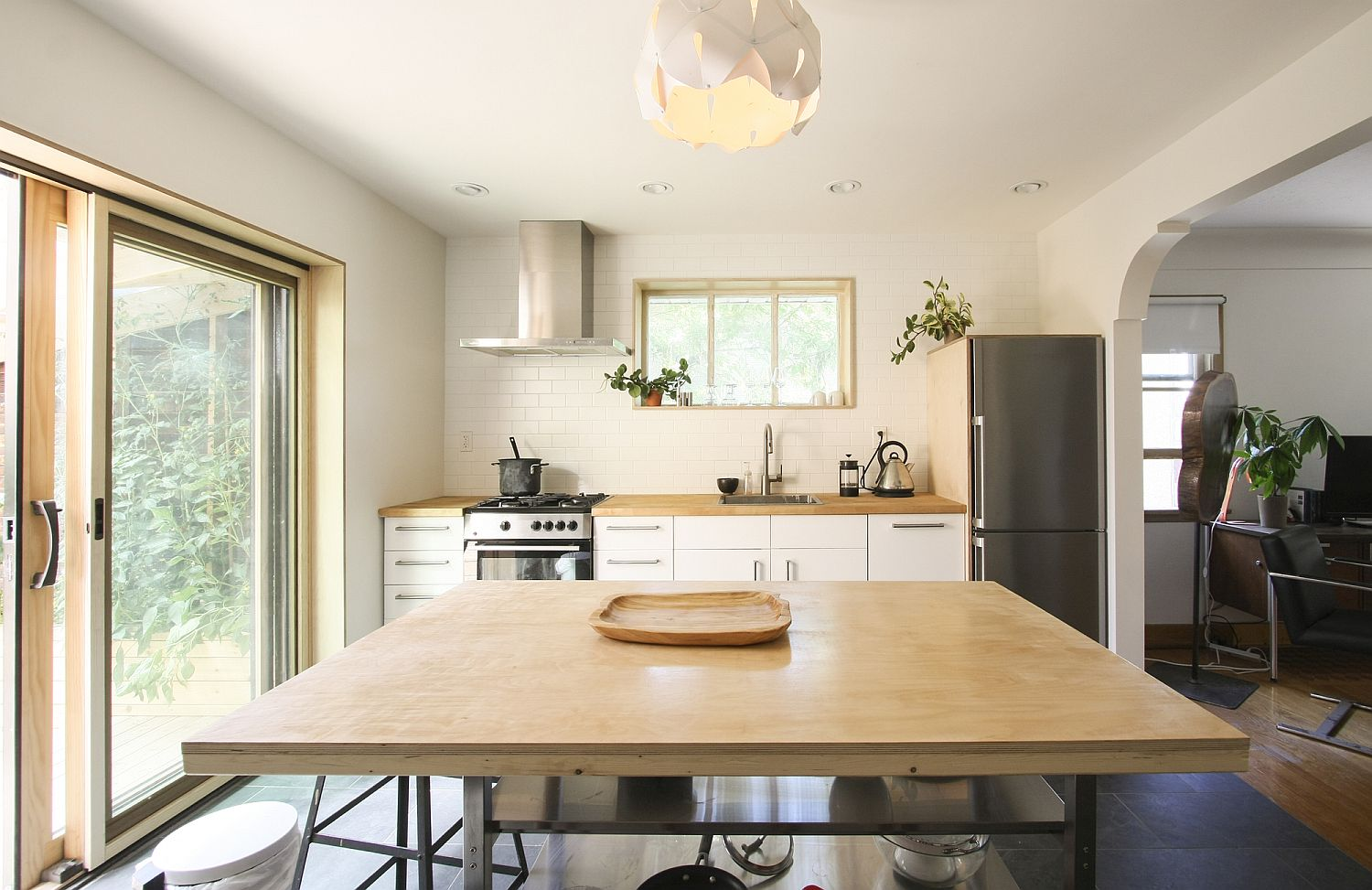 Kitchen and small dining space rolled into one inside this Canadian home