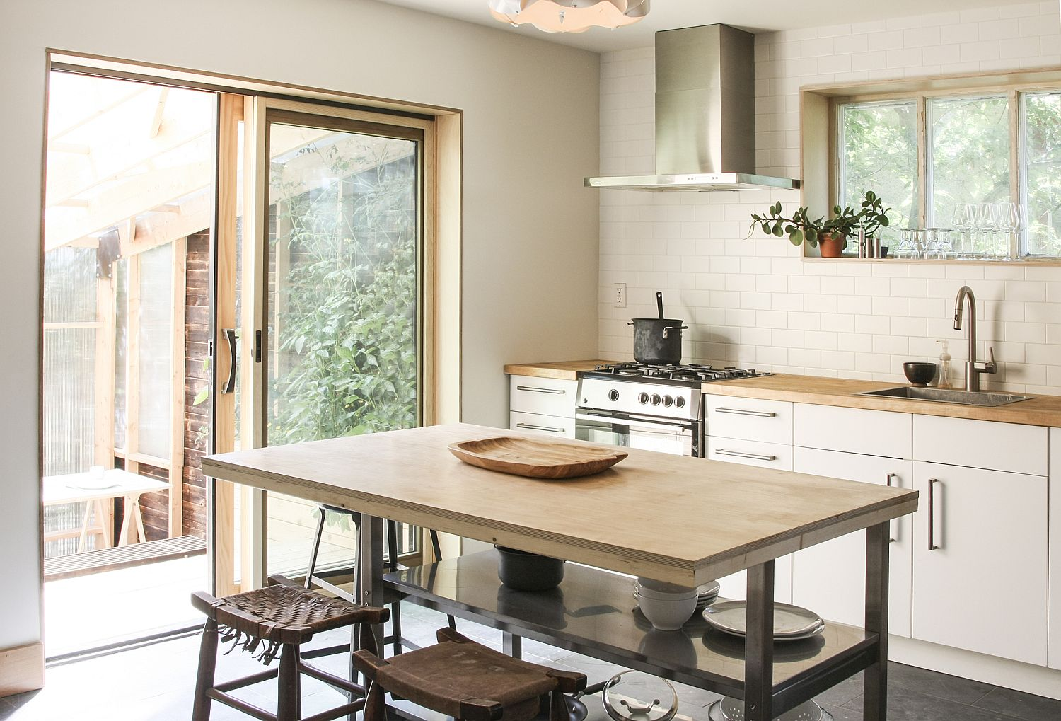 Light-filled kitchen with a casual central island and breakfast zone