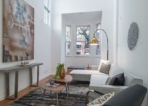 Light filled living room of Vancouver loft with high ceiling 217x155 Historic Bay Windows Become a Part of this Polished Vancouver Loft