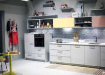 Lighter-shades-of-blue-gray-and-pops-of-color-give-the-kitchen-a-retro-touch-217x155