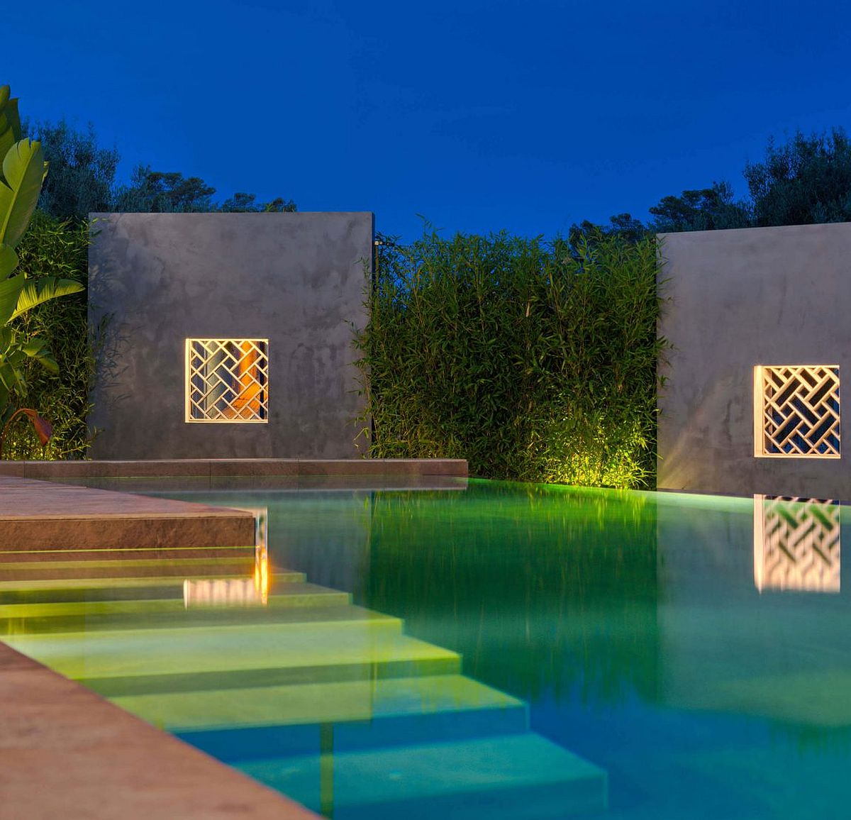 Lighting brings dramatic flair to the pool area of the Spanish home