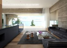 Living area clad in concrete wood and leather with modern minimalism 217x155 Sunset House: Exhilarating Ocean Views Laced with Luxurious Minimalism