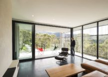 Living area of the Mount Macedon House that flows into the balcony 217x155 Corten Cladding and Bushland Views Mesmerize at Mt Macedon House