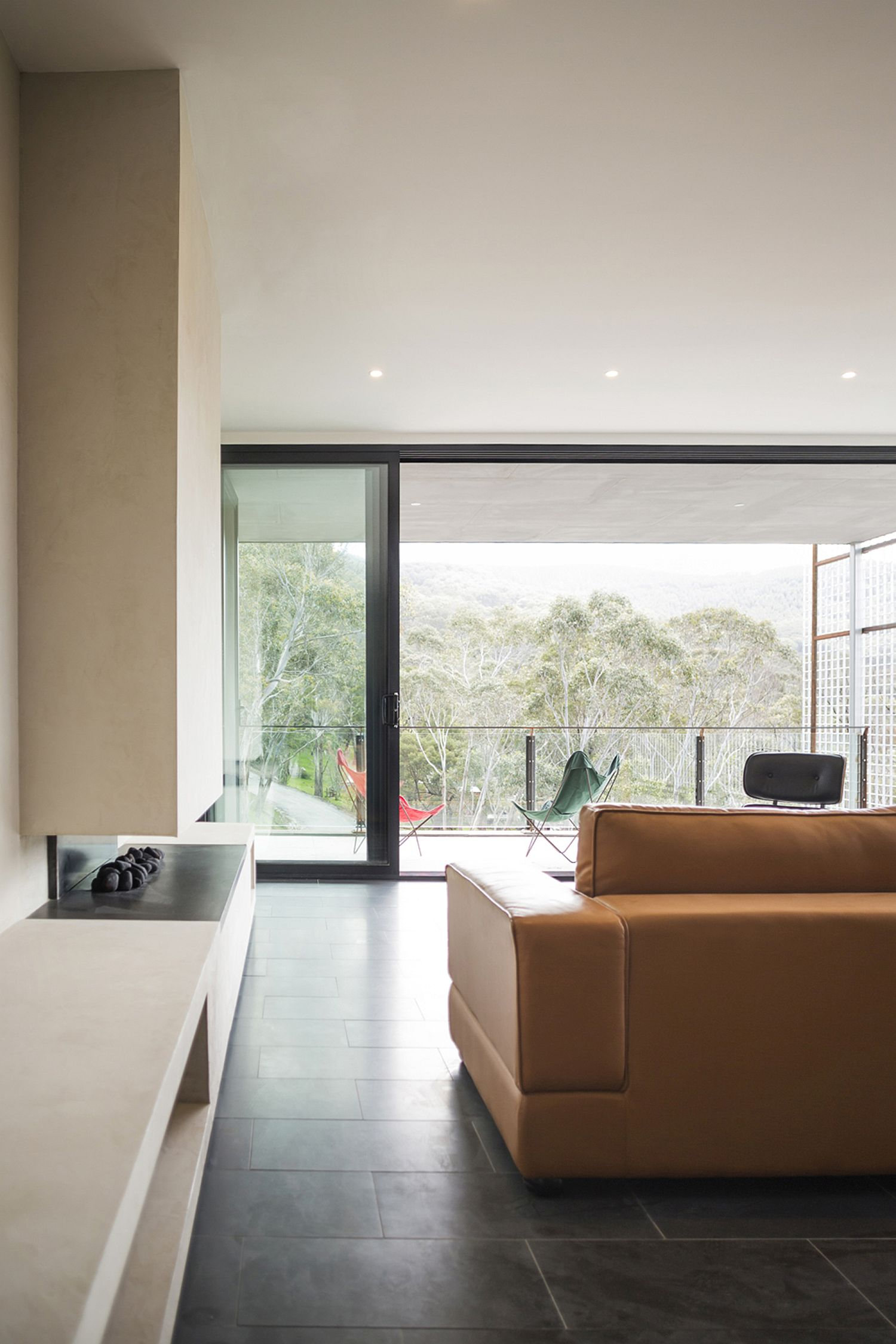 Living room with a view of the Aussie bushland and ample natural light