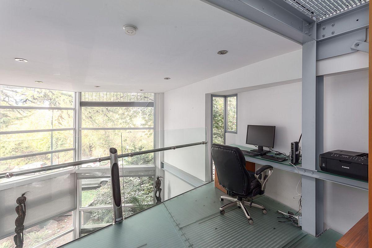 Mezzanine level home workstation with glass flooring