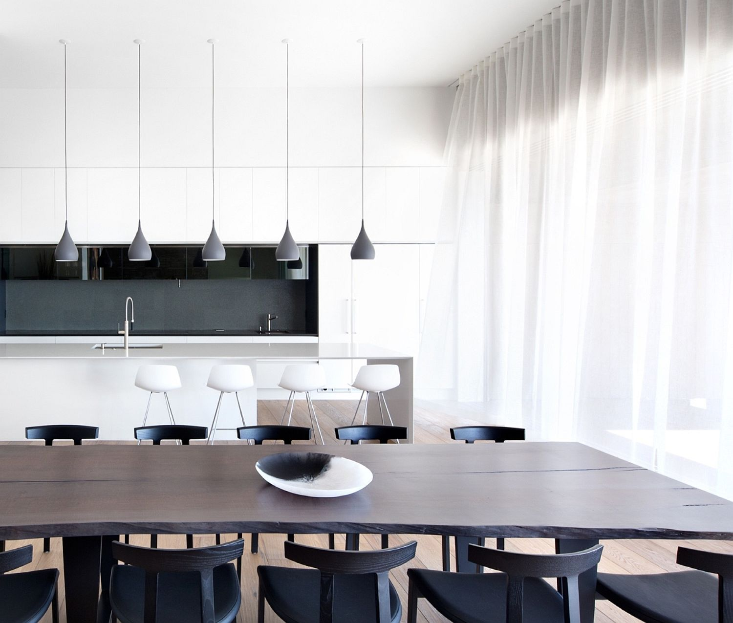 Minimal kitchen and dining room in white, black and gray