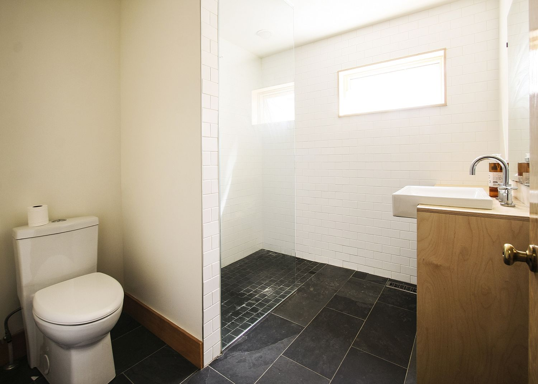 Modern-bathroom-and-corner-shower-area