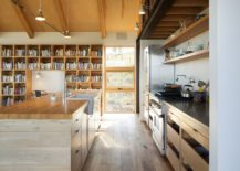 Modern-kitchen-with-open-shelves-and-a-bookshelf-in-the-backdrop-217x155