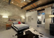 Modern rustic bedroom with limestone rubble veneer headboard wall 217x155 Trendy and Sustainable: Natural Stone Makes a Rocking Comeback in 2017