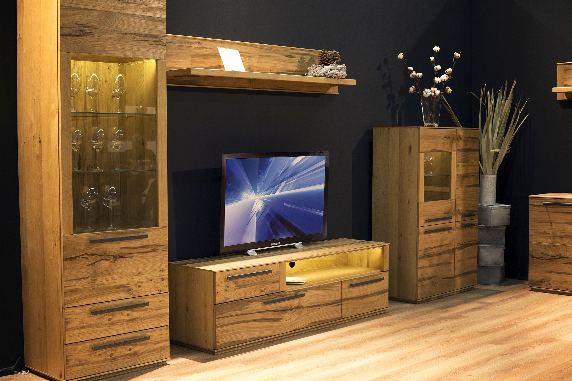 Move away from glossy finishes to embrace the warmth of wood