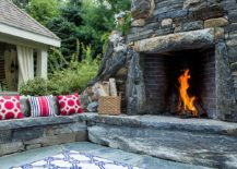 Natural stone fireplace and stone seating shape a stunning outdoor nook 217x155 Trendy and Sustainable: Natural Stone Makes a Rocking Comeback in 2017