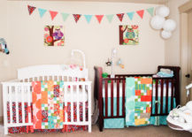 Nursery-with-two-differently-colored-cribs--217x155
