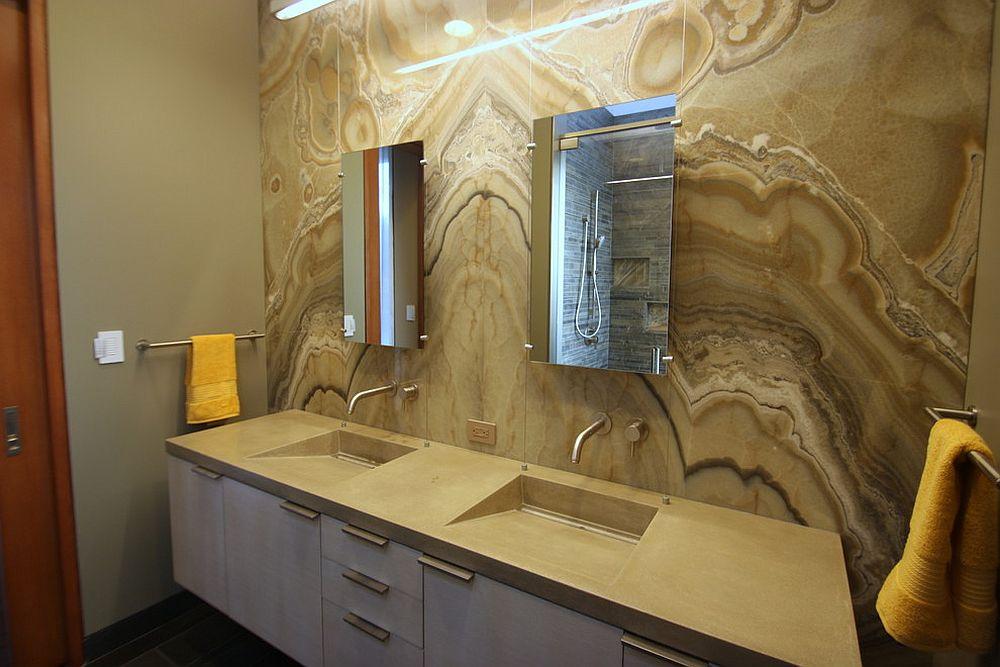 Onyx brings a sense of dramatic elegance to an understated modern bathroom in neutral hues