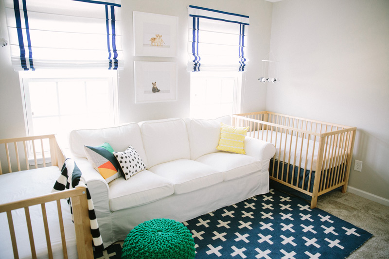Open and spacious nursery with sailor blue drop-down curtains