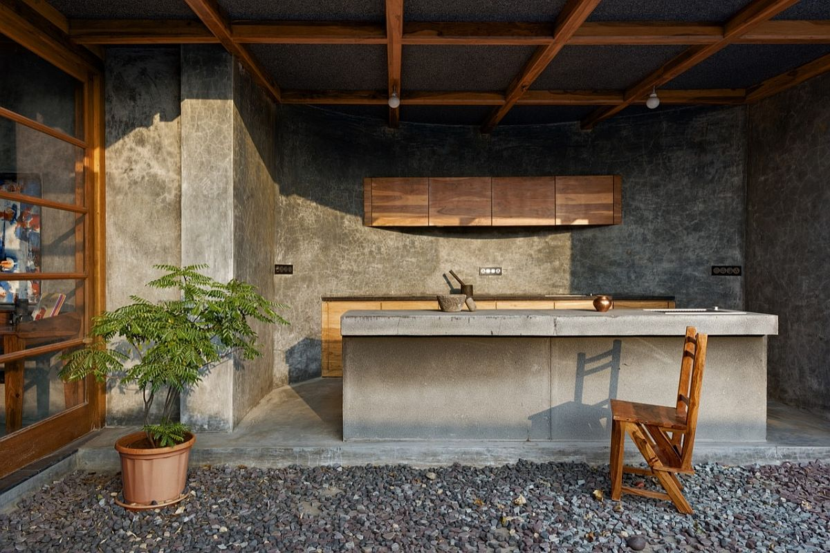 Open pantry overlooks the terrace garden filled with gravel path