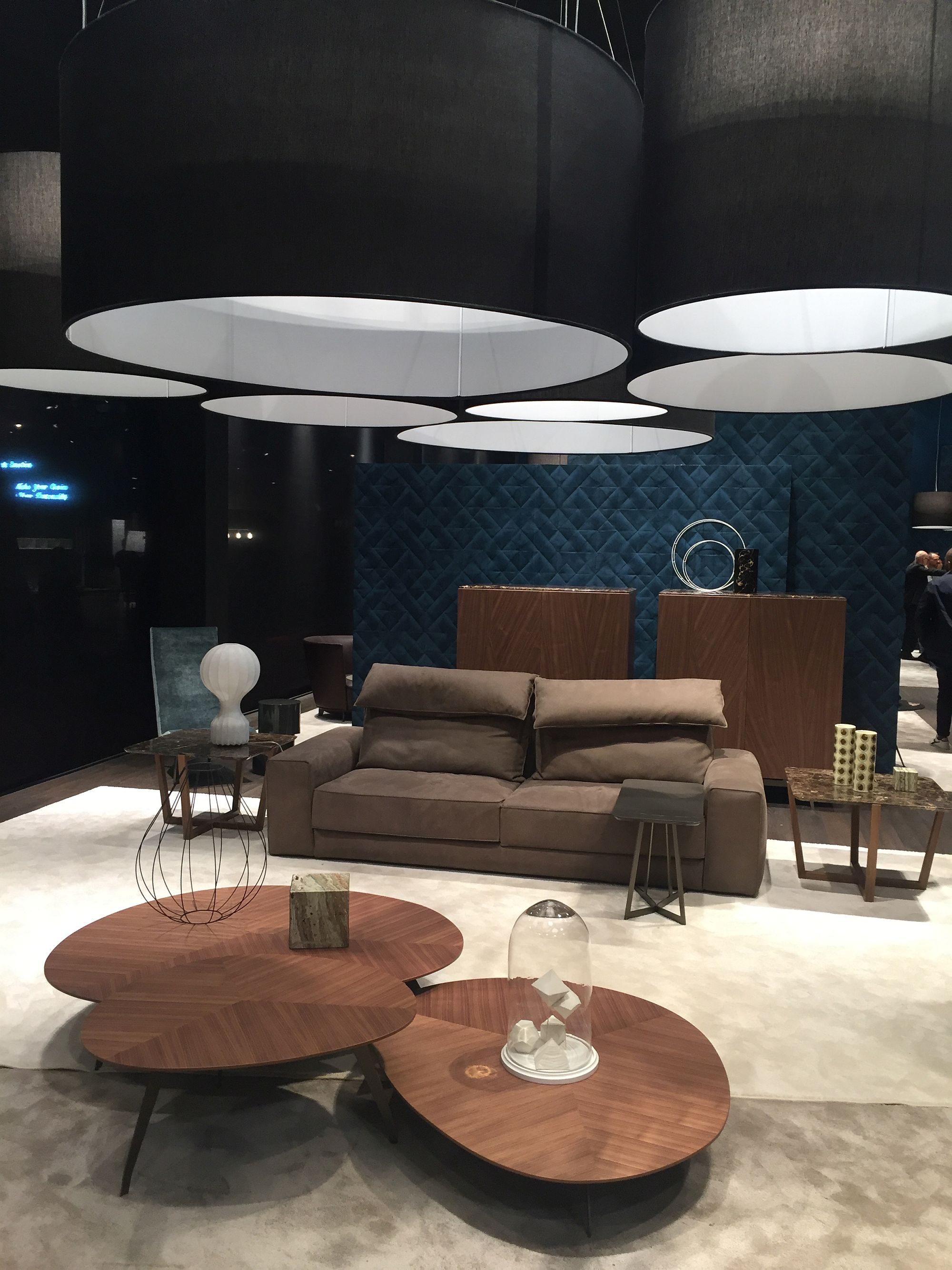 Posh contemporary living room with a trio of coffee tables