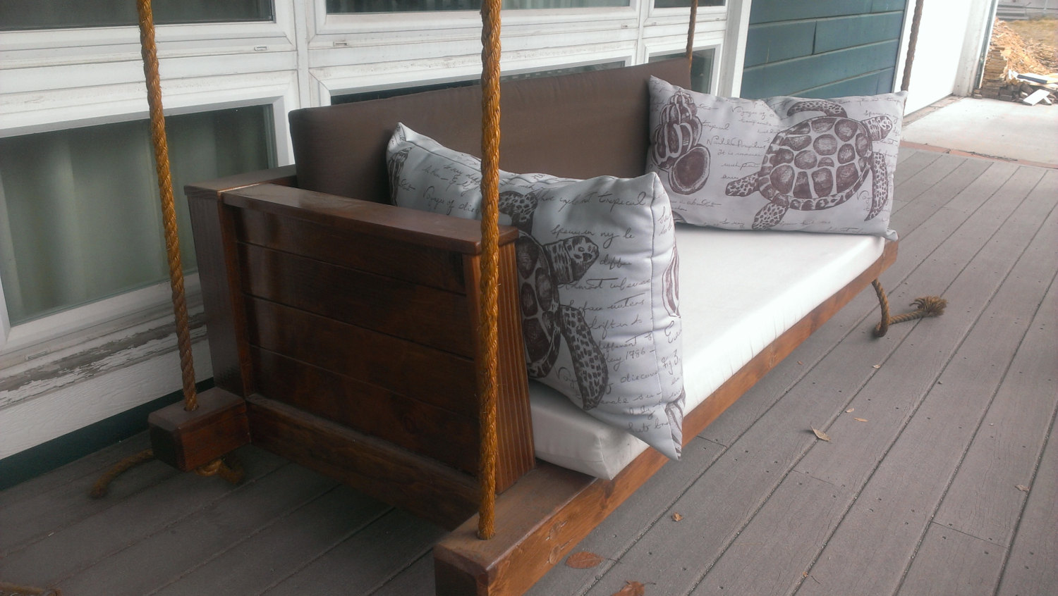 Rustic barn styled porch swing