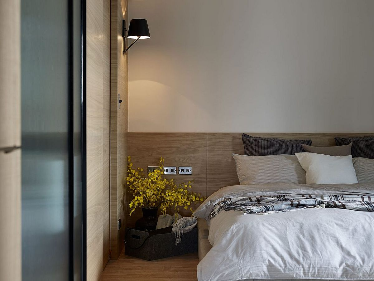 Sconce lights bring space-savvy illumination to the bedroom