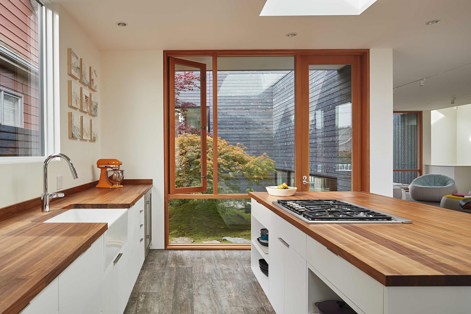 Skylight along with the large window bring natural light into the lovely kitchen