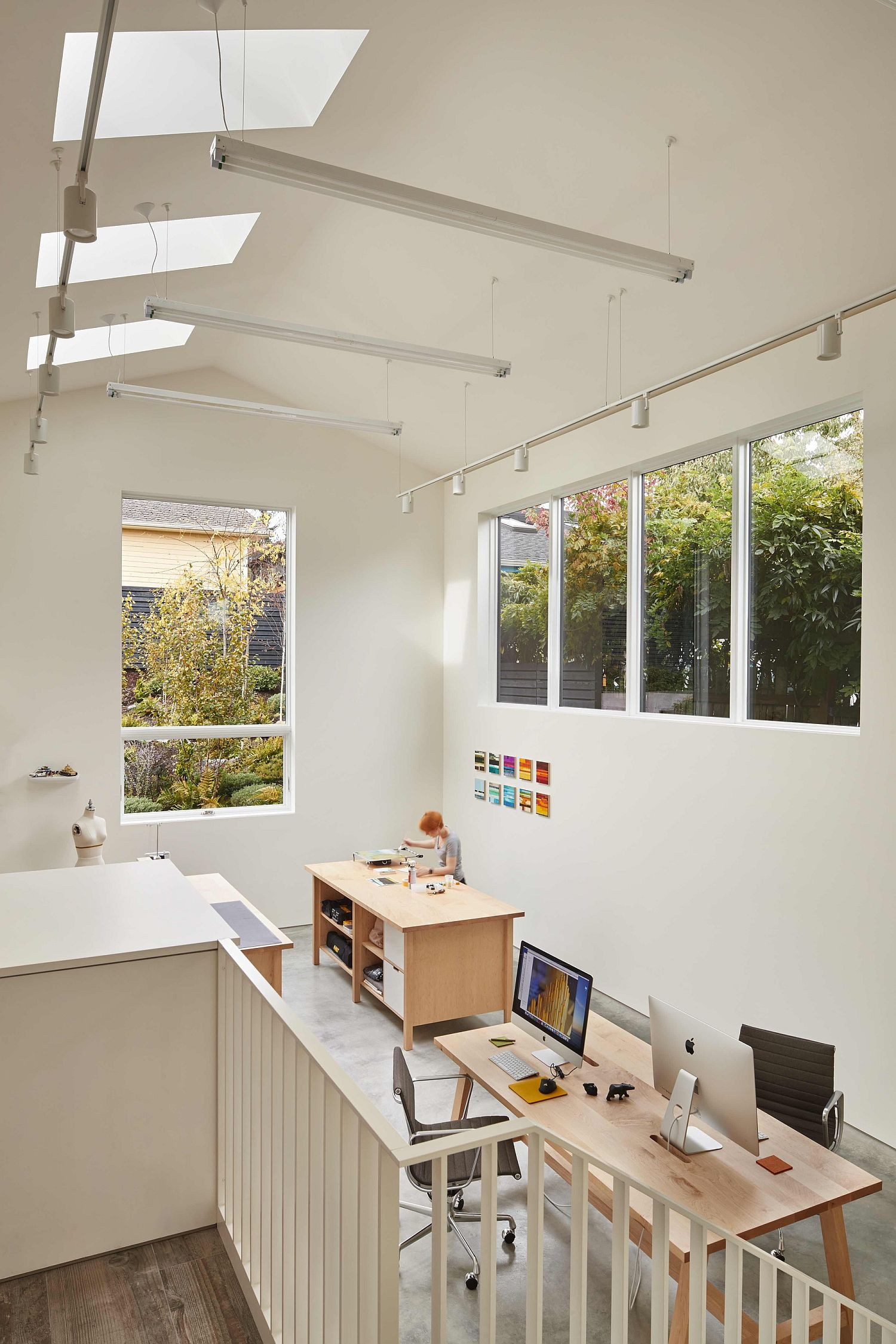 Skylights usher in a flood of natural light into the modern home office