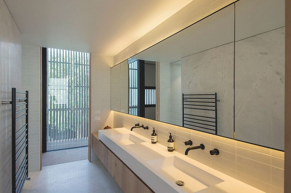 Sleek and small contemporary bathroom in white and gray