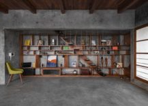 Sleek-floating-staircases-blends-into-the-woodsy-backdrop-of-the-home-library-217x155