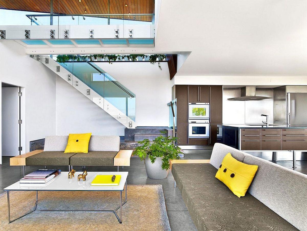Sleek-glass-walkway-becomes-a-part-of-the-living-room-aesthetic-below