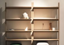 Slim-and-open-wooden-shelf-with-ample-space-for-both-books-and-decorative-pieces-217x155
