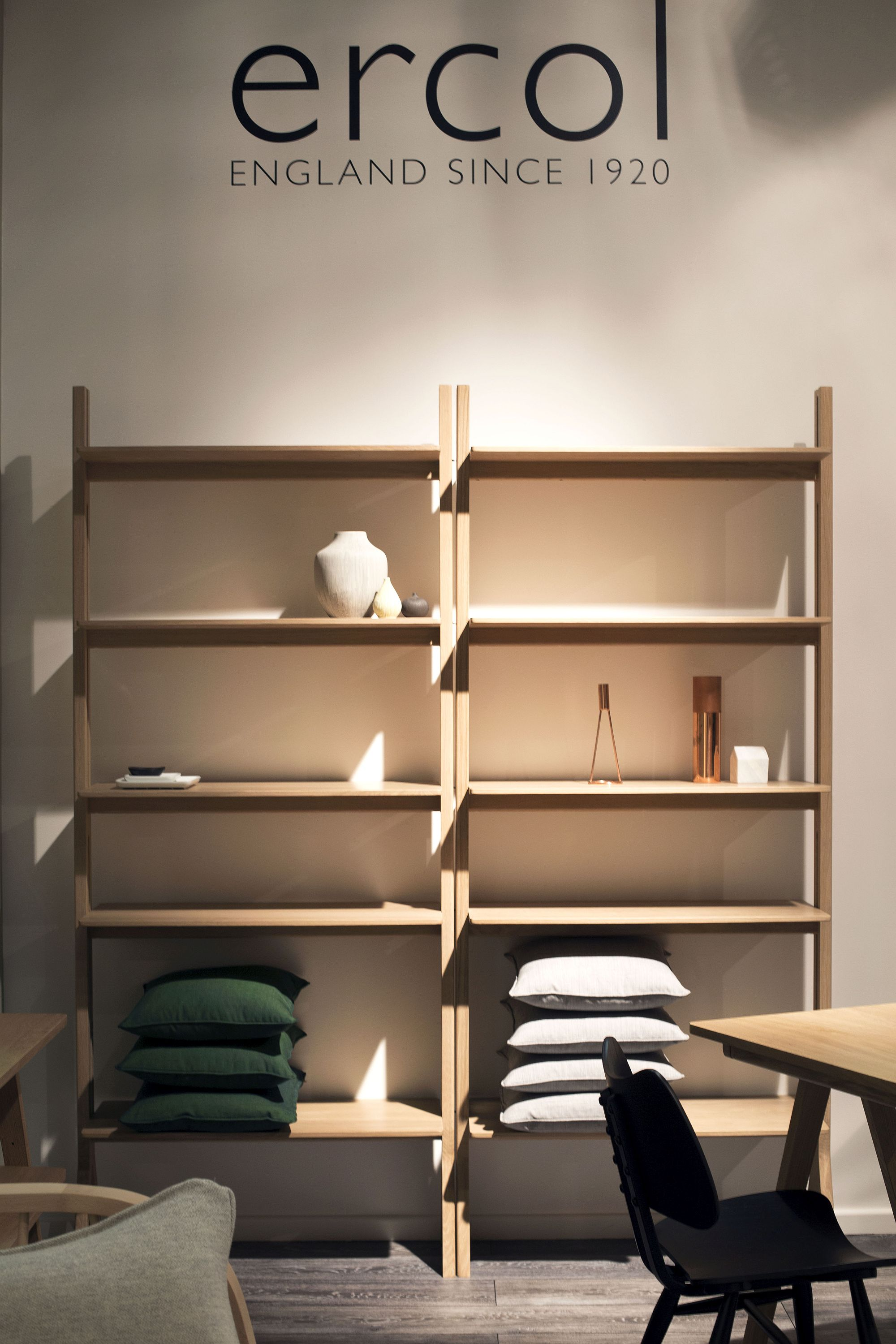 Slim and open wooden shelf with ample space for both books and decorative pieces