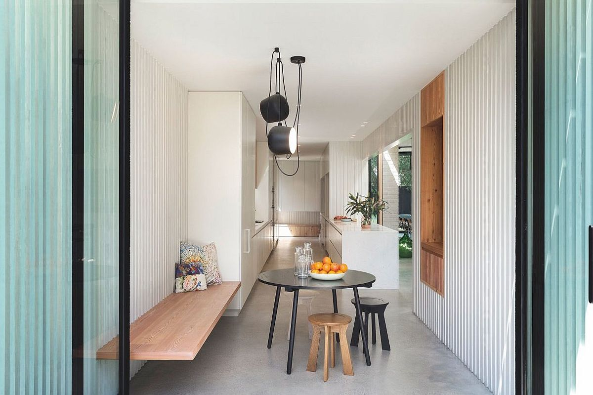 Small breakfast zone and bench makes perfect use of space