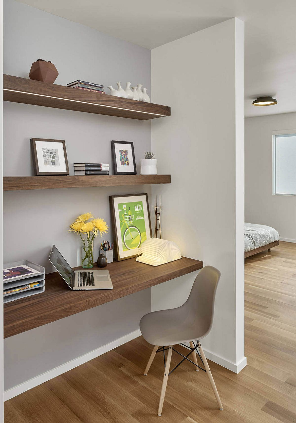 Small-workspace-in-the-bedroom-corner-with-floating-wooden-shelves