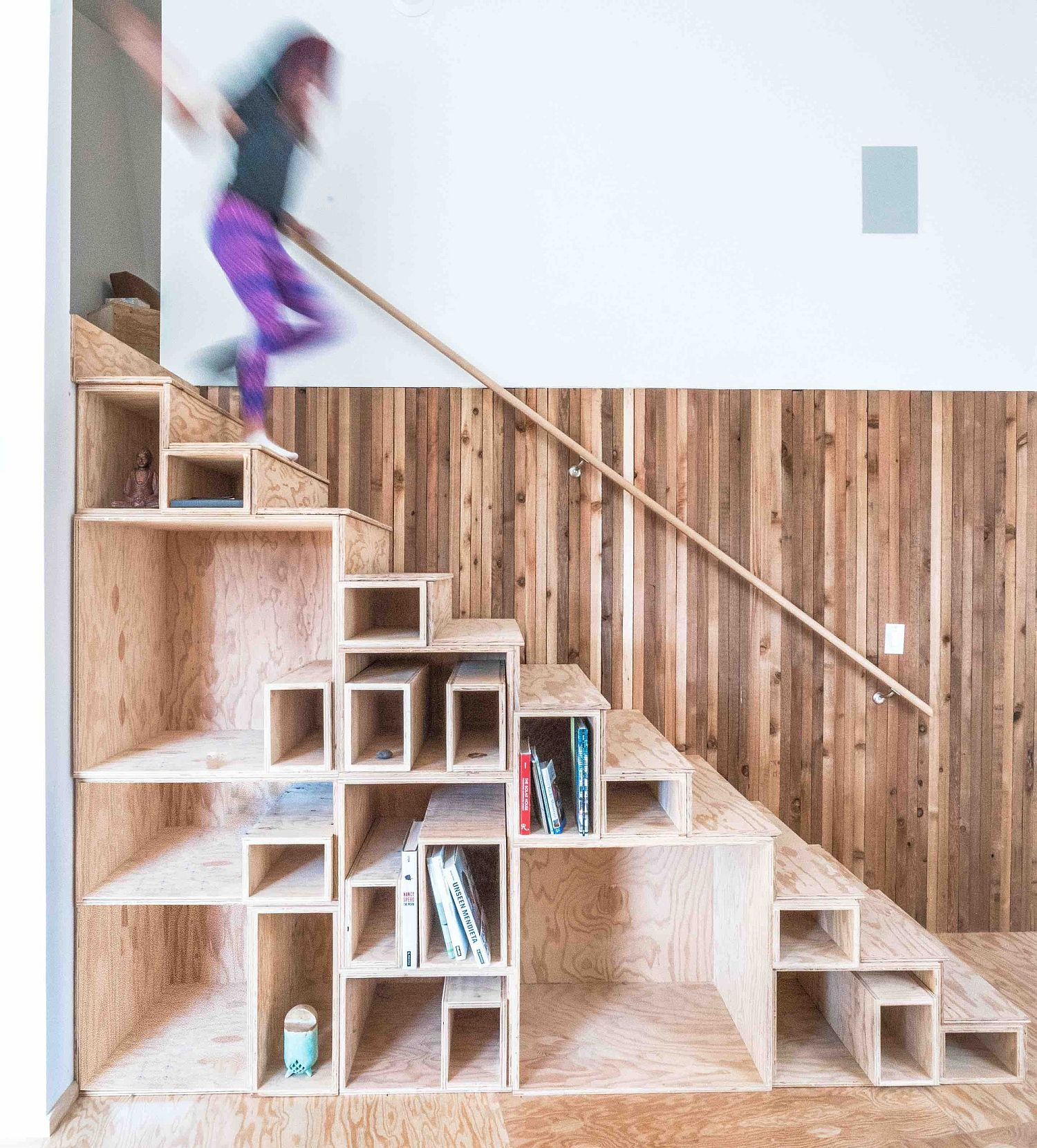 Space-savvy staircase design with built-in shelving