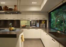 Spacious-contemporary-kitchen-makes-smart-use-of-corner-space-217x155