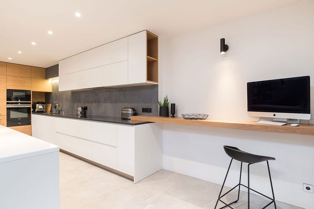 Spacious kitchen with home workspace next to it